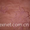 Embroidering woven suede
